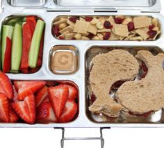 PlanetBox, Healthy lunches ideas, recipes, and menus | PlanetBox  I bought one of these for the Monk last year. Well worth the price and he will use it year after year. Plus no lids for him to open!