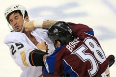 Patrick Bordeleau #58 of the Colorado Avalanche lands a punch on Brad Staubitz #25 of the Anaheim Ducks as they engage in a fight at the Pepsi Center on February 6, 2013 in Denver, Colorado. (Doug Pensinger, Getty Images)