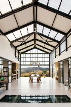 Open air dining area features polished concrete floors and high vaulted ceilings in this home outside of Pretoria, South Africa. Design Jobs, Layout Design, Design Ideas, Logo Design, Architect House, Architect Design, Architect Logo, Conservatory House, Casas Containers