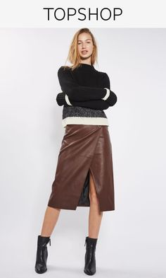 Keep your midi look current with this burgundy PU skirt, featuring a wrap design and hardware detail at the waistband. Pare back with patent ankle boots and a sequin-sleeve sweatshirt for an edgy appeal.