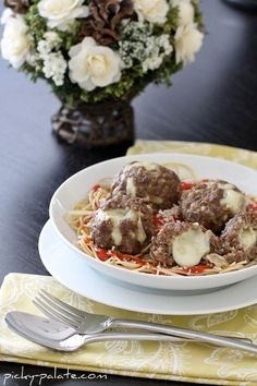 Mozzarella stuffed homemade meatballs -  I'm getting hungry just looking at these - all that gooey cheese just oozing out of the meatballs?  Yum!  I'd use a ground beef/ground pork combo tho ...
