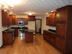 Kitchen of the Levenson with upgraded cabinetry (12-51)  Granite Countertops and kitchen cabinets
