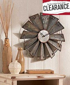 Inspired by a classic farm landmark, this #Metal Windmill Wall Clock is the perfect coordinating piece for your country decor. Each blade has the hour embossed i...