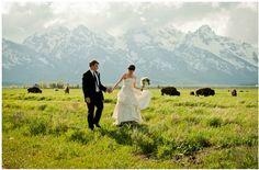Amazing Jackson Hole wedding photo complete with Grand Tetons and buffalo.