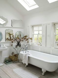 Vintage Mirrors - displayed on narrow shelves in a bathroom. This is such a smart and safe way to showcase old mirrors and very easy to rearrange - The Dreamery