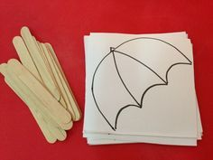 Umbrella Craft with popsicle sticks! Great activity for discussing the weather and learning colors!