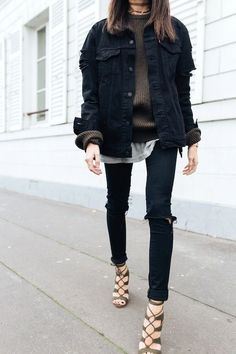 To pull if off, you'll need an oversized black denim jacket, a brown ribbed sweater