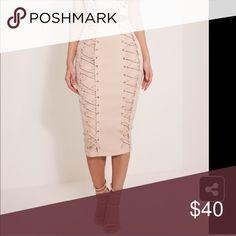 Lace down midi skirt! Totally unique midi skirt. It's such good quality, and wearable in the colder months. Kind of a nudist, peach color. Wear this with a crop top or even better... The matching bandeau in my closet and some strappy heels. New with tags. Very discounted. It's killing me to not be able to wear this. I have the matching bandeau top as well, but it is just too big for me. Nasty Gal Skirts Midi