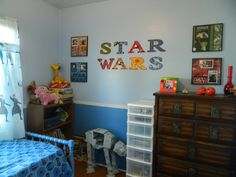 """My grandson's """"Star Wars"""" themed bedroom using 12x12 framed pages of family and friends."""
