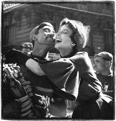 Richard Avedon - Dorian Leigh with bicyclist, dress by Dior, Champs-Elysées, Paris, August 2, 1949