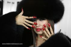 Black Fox Fur's and Long Red Nails.