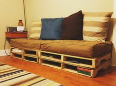 "DIY pallet furniture: Transforming a Futon into a Couch (this involves cutting a queen-size futon into 4 pieces--but how??). ""And the best part, we can unstack the pallets, push the four pieces of futon together, put a thin foam pad on top and it makes a great bed."""