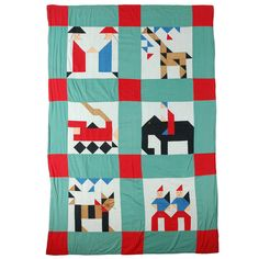 Fantastic & Folky Pictorial Mounted Crib Quilt/circa 1930's   From a unique collection of antique and modern quilts at http://www.1stdibs.com/furniture/folk-art/quilts/