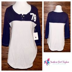 """FREE PEOPLE Basic Tee Number Tunic Soft Slouch Top Size XS. New with tags. $68.00   Super soft and stretchy athletic inspired 3/4 sleeve featuring number graphic on bust.  Optional button closure at neck.  Loose fitting with partial raw trim.   Measurements for size XS: Bust: 35"""" Length: 28.5"""" Sleeve: 14.5""""   ❗️ Please - no trades, PP, holds, or Modeling.   ✔️ Reasonable offers considered when submitted using the blue """"offer"""" button.    Bundle 2+ items for a 20% discount!    Stop by my…"""