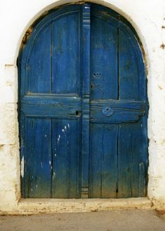 Blue door, like the windows to the soul, your color intrigues me and makes me want to find out what is whithin your beautiful depths.