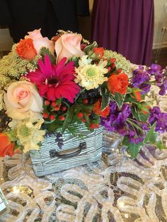 Vintage table arrangement created from bright & cheerful summer mixed florals. By 1800Flowers|Flowerama Iowa City