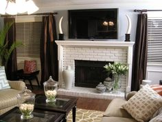 Learn how to give your dated fireplace a makeover with the addition of staircase posts, molding and a coat of fresh paint. >> http://www.hgtv.com/design/decorating/design-101/how-to-build-a-new-fireplace-surround-and-mantel?soc=pinterest