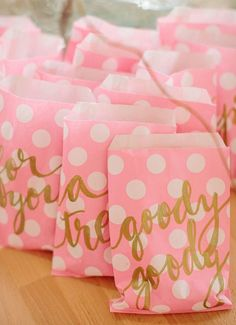 Pink and gold favor bags.  Find similar bags here: http://www.confettiandco.com.au/polka-dot-paper-party-treat-favour-bags-blush-pink/