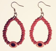 Red evil eye hoop earrings by chipina