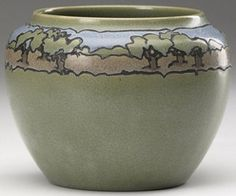 A Saturday Evening Girls pottery vessel decorated by Tillie Block, cuerda seca with a band of trees in a landscape, painted in polychrome on a matte green ground, 1913; Arts and Crafts; Craftsman bungalow