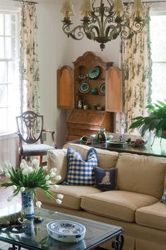 The blue and white pieces greatly compliment this room.