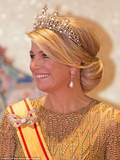 Queen Maxima glitters in gold dress and Pearl tiara and earrings, Diamond bow brooch. as she and husband Willem-Alexander join Emperor Akhito and Empress Michako for a state dinner in Tokyo