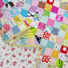 Checkerboard Quilt II - A Finished Quilt. I love the mix of a simple patchwork, bright binding and lovely vintage-y floral backing.