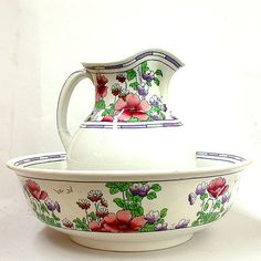 ARTS & CRAFTS BASIN SET. Losol Ware June pattern  pitcher and basin by Keeling & Co. England. White ceramic with frieze of poppies and other flowers in red and purple with green leaves, frieze edges in blue. Marked: Losol Ware, June, (crown mark) Keeling & co. Burslem England.