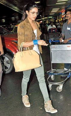 Priyanka Chopra wearing a wrist support band at the airport on her way to Los Angeles to launch her celebrity milkshake. #Bollywood #Fashion