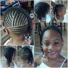 Love the design in the back! Multidirectional cornrows updo for little girl