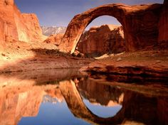 Rainbow Bridge Reflection, Rainbow Bridge National Monument, Utah Lake Powell Glen Canyon National Recreation Area It's ~ m. Navajo Mnt in the background is high contains magnetite. Have seen an unreal lighting show over it from the S tip of Bryce Canyon. Oh The Places You'll Go, Places To Travel, Places To Visit, Travel Destinations, Barack Obama, Lake Powell Utah, Utah Lake, Alaska, Natural Bridge