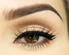 Strong eyebrow game, perfect winged eyeliner, and perfect eye makeup.
