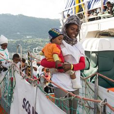 A woman and child disembark from the MV Aquarius on 5 October, after spending two days aboard the ship which rescued them along with some 720 others on 3 October off the coast of Libya. Since 21 April, when MSF's search and rescue operations began for 2016, the Dignity I, Bourbon Argos and Aquarius have rescued a total of 14,547, people in more than 100 different rescue operations, whilst at least 3,230 people have died in what has become the most deadly migratory route in the world. MSF…