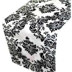 White Table Runner with Black Damask Flocking.. $3.39 each so..with a teal table cloth...it would look really pretty and would be cheap