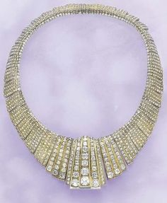 An Art Deco Diamond Necklace circa 1925. Designed as a series of graduating curved rigid links entirely decorated with old-cut diamonds, mounted in gold and silver, with French assay marks.