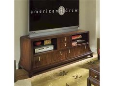 Shop for American Drew Entertainment Unit, 591-585, and other Home Entertainment Entertainment Centers at Barrs Furniture in McMinnville, TN. 2 Open Compartments with glass Shelf in each, 4 drawers, wire management on Left Side Facing back panel.