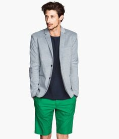 Shop this look for $99:  http://lookastic.com/men/looks/light-blue-blazer-and-navy-crew-neck-t-shirt-and-green-shorts/2794  — Light Blue Blazer  — Navy Crew-neck T-shirt  — Green Shorts