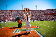 Edmondson led Florida football fans in their traditional Mr. Two Bits cheer for 60 years, beginning in Football Field, Football Fans, Football Season, Florida Gators, Florida Athletics, Goals And Objectives, Postnatal Workout, University Of Florida, Wellness Programs