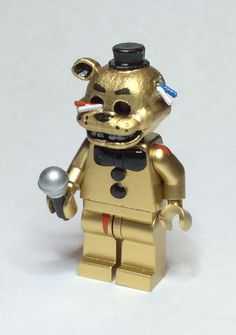 Beware the night with this Golden Freddy Fazbear Lego minifig.