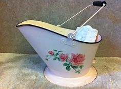 I use this vintage enamel bucket to hold rolled up towels.