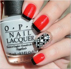 red nails with black french tips, black and white raster design + square studs