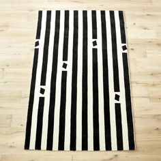 Shop pause hand-loomed rug.   Graphic, minimal, abstract––how designer Bryn E.  Namavari describes her creation.