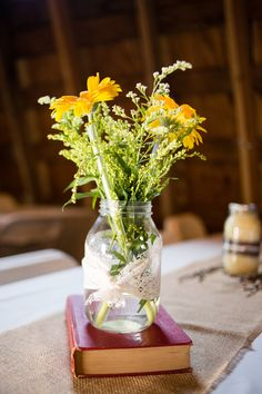 Rustic Mason Jar Centerpiece  Sweet Yellow & Grey Barn Wedding Photographer: Miranda Lynn Photography