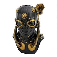 "Steampunk Apocalypse Gas Mask Statue. by artist Bob Basset. Boasts a gramophone for hearing and no end of techno-Victorian charm! Cast in quality designer resin with retro details including straps, valves, hoses and a back zipper. Hand-painted to call attention to the faux leather, brass and copper fittings.  7""Wx4½""Dx10"""
