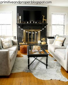 Black Painted Brick Fireplace Makeover & Cowhide Rug from Rugs USA - Primitive and Proper