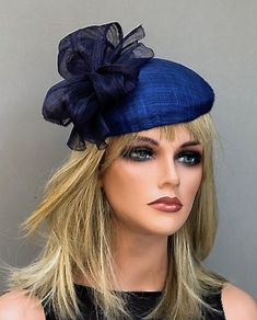 I lined this royal blue and navy blue hat with a black inner lining. The sclupted silk abaca trim is on trend with top Brittish milliners. Available at: AwardMillineryDesign.com