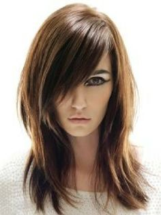 Medium-Length-Straight-Hairstyle-with-Side-Swept-Bangs-and-Layers