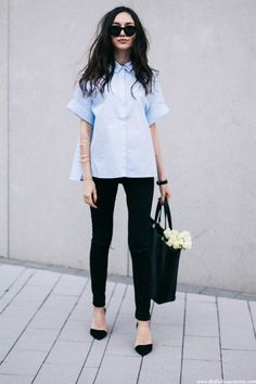 Short sleeved shirts are summer garments that make your look more casual but very stylish. Create an all day outfit by combining this blue shirt with black denim pants and pointy heels, sunglasses and a statement necklace.