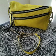 OrYANY......STUNNING GENUINE LEATHER .PURSE ...EXCELLENT CONDITION. ..NWOT. ...BRAND NEW ...NO FLAWS  ...STUNNING GORGEOUS ...A MUST HAVEEEEE  ...true to its size and color ...color...NEON YELLOW. ...100%...GENUINE LEATHER ...AUTHENTIC. .OrYANY PURSE ...2 pic up close ...zipper DECO as shown ...zipper pockets on front ...silver chrome ...studs accents ...chain ...shoulder straps  ...outside pocket ...zipper pocket inside  ...inside compartments  ...measurements. ..adding soon ...better in…