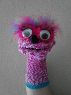 Super-cute.  made by a puppet-loving friend!  Fuzzy Sock Puppet by NickisDigitalDesigns on Etsy, $10.00.